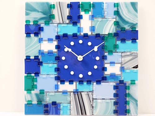 A decorative fused glass wall clock