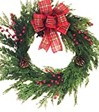Traditional Christmas Cedar Wreath Natural Looking Artificial Evergreens Red Berries Pine Cones Handmade Tartan Plaid Bow Will Fit in Between Storm Doors 22 Inch Diameter 4 Inches Deep Use All Winter