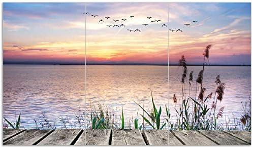 Wallario Herdabdeckplatte/Spritzschutz aus Glas, 3-teilig, 90x52cm, für Ceran- und Induktionsherde, Seepanorama mit Schilf und fliegenden Vögeln