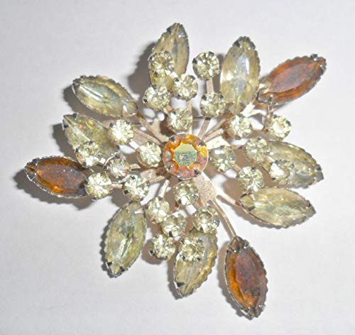 Pretty vintage goldtone brown and pale yellow green rhinestone brooch signed Pakii ()