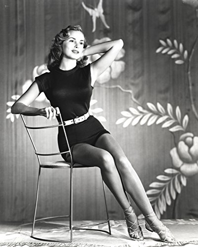 Janet Leigh sitting on Thin Metal Chair in Black Silk Belted Sleeveless Dress with Legs Crossed and Left Arm Rest on the Top Railing Photo Print (24 x 30) ()