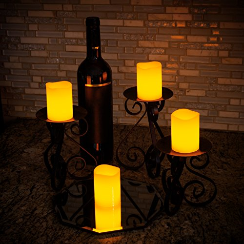 LED Flameless Candles - 12 Pack Ivory Real Wax Pillar Votive Centerpieces With Soft Amber Light and Warm Glow - Batteries Included - by Light Me Up