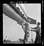 1942 Photo Parris Island, South Carolina. U.S. Marine Corps glider detachment training camp. A barrage balloon takes to the air under capable handling by a Marine Corps ground crew Location: Beaufort