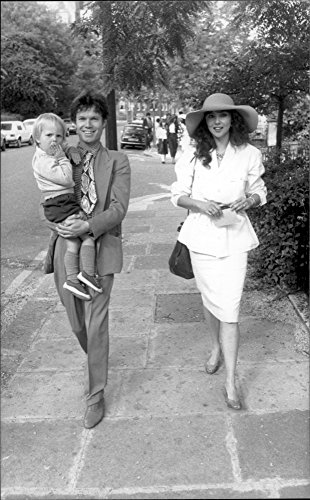 Origin photo of Mick Jagger's brother Chris and Marie Helvin, close friend of Jerry Hall, on their way to the church for the baptism of Elizabeth Jagger.