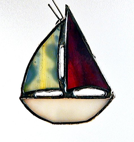 Stained Glass Sailboat (White stained glass Sailboat, red, blue, green, yellow, pink, multi colored combination of sails.)