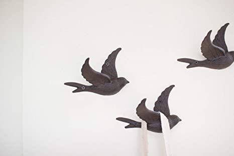 Amazon.com: Hierro fundido Flying Bird gancho de pared: Home ...