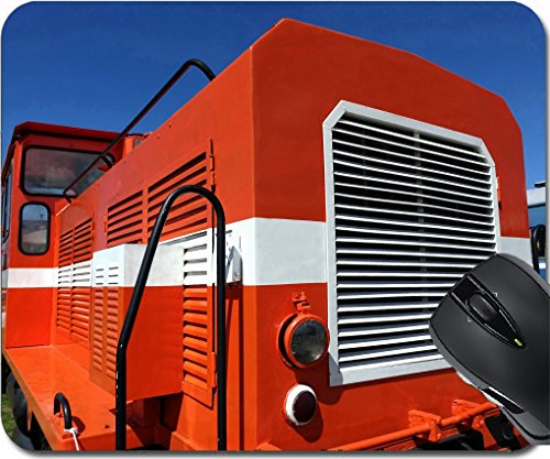 ads/Mat design 30562112 A vintage diesel engine in red and white against a blue sky ()