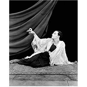 Buster Keaton 8 inch by 10 inch PHOTOGRAPH The Unspecific Steamboat Bill, Jr. The Cameraman Full Body Sitting on Carpet Holding Flower kn