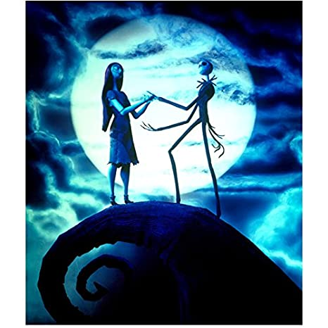 blue tone jack skellington and sally on mountaintop among clouds in