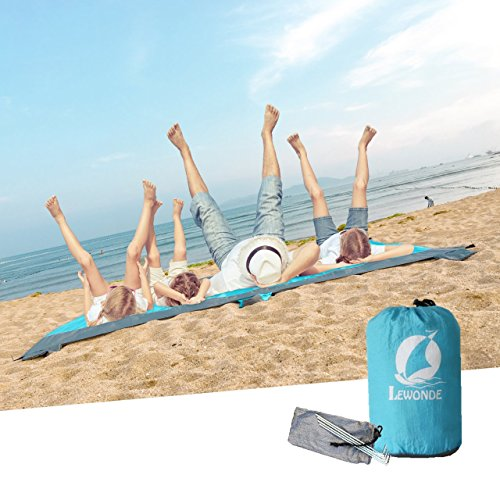LEWONDE Sand Escape Beach Blanket - 7x9 Oversized Lightweight Picnic Mat- Fordable Waterproof - 4 Sand Bags, Zippered Valuable Pocket - Free Ground Anchors - Ideal Family Travel Kit