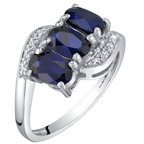 (14K White Gold Created Blue Sapphire and Diamond Three Stone Anniversary Ring 1.50 Carats Oval Shape Size 7)
