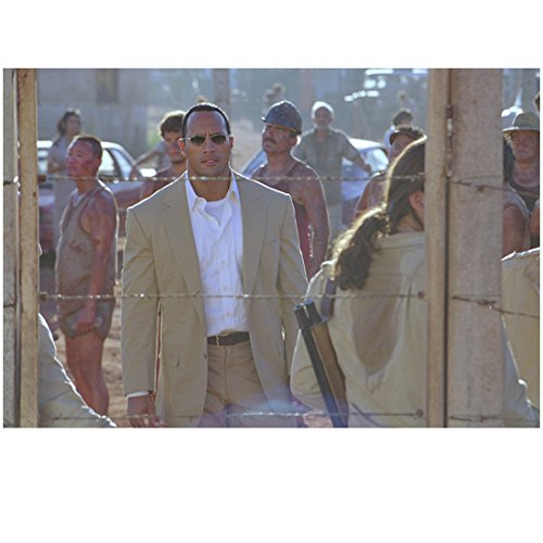 The Rundown 8 inch x 10 inch PHOTOGRAPH Dwayne Johson Khaki Suit White Shirt & Sunglasses in Front of Guarded Barbed Wire Fence - Sunglasses Dwayne