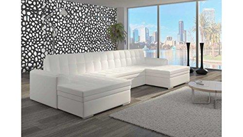 divano angolare ad u in pelle bianca con tappeto grigio.