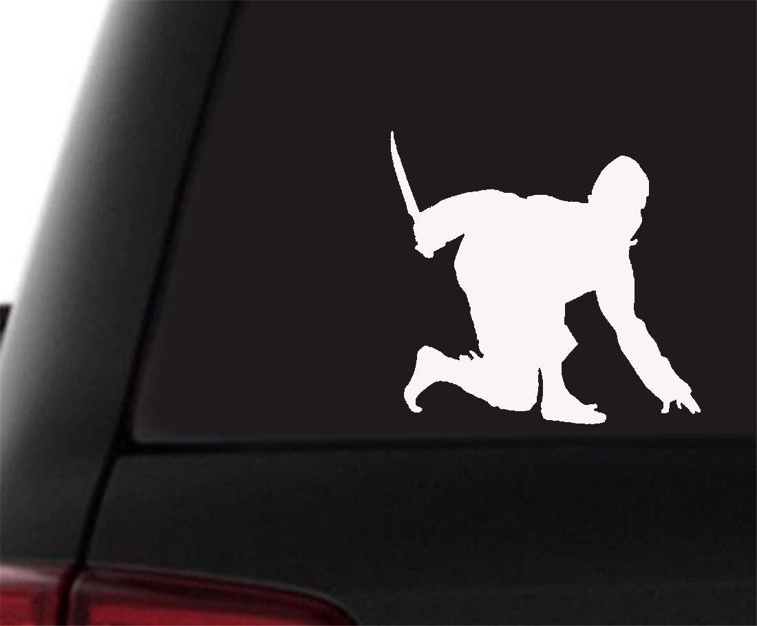 Ninja se agachó con la daga Etiqueta de la ventana del coche ...