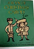 img - for A BOOK OF CHRISTMAS CAROLS Arranged for piano, with guitar chords by Robert de Cormier book / textbook / text book