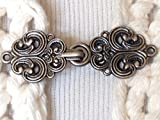 The mattie silver tone metal Celtic swirl sweater clip clasp