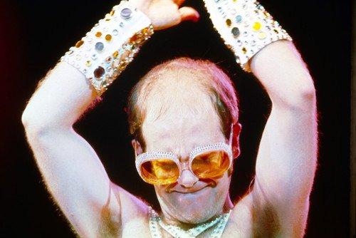 Elton John classic sunglasses and sleeveless outfit iconic 24x36 Poster from Silverscreen