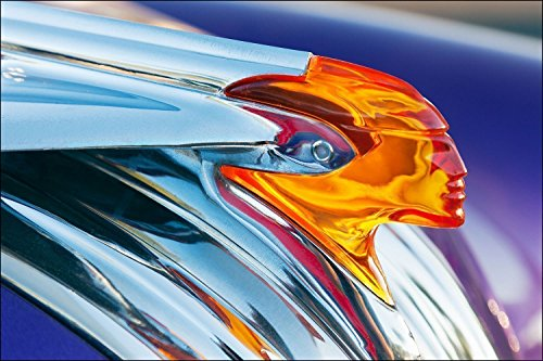 Photograph of a 1950's Pontiac Indian head hood ornament