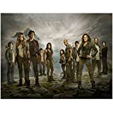 The 100 8 x 10 Cast Photo Dirty Standing on Rocks and Grass Mountains and Grey Sky in Background kn