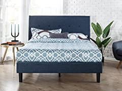 This classic upholstered platform bed by Zinus will transform your bedroom. It ships in one carton with the frame, legs and ten wooden slats conveniently located in the zippered compartment in the back of the headboard for easy assembly. This...