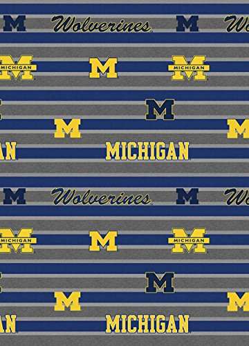 UNIVERSITY OF MICHIGAN COTTON FABRIC-MICHIGAN WOLVERINES POLO STRIPE COTTON FABRIC-NEWEST DESIGN-SOLD BY THE ()