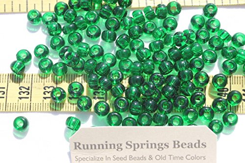 - 1/0 Seed Beads Glass Trans Christmas Green Crafts Jewelry Making 6 x 5mm /1oz. Perfect for Earrings, Necklaces or Bracelets.