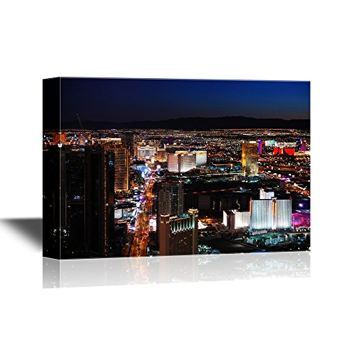wall26 - USA City Skyline Canvas Wall Art - Las Vegas Strip Skyline Night Scene with Hotel Illuminated - Gallery Wrap Modern Home Decor | Ready to Hang - 24x36 inches]()