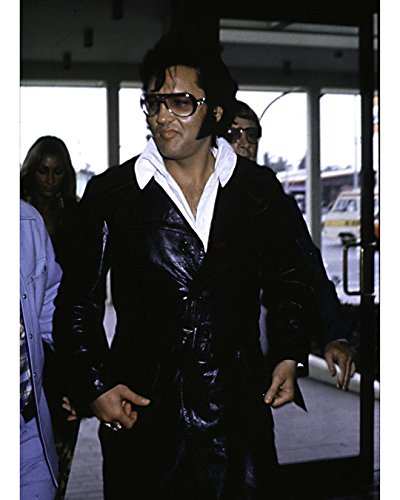 Elvis Presley Wearing Sunglasses And A Leather Jacket - 11