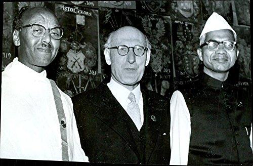 Vintage photo of Fosterlandsstiftelsen Foundation 100229;rsh246;gtidlighet. Mission Director Nils Dahlberg surrounded by Embaye Habtesghi, Eritrea, television and Indian AT Rao