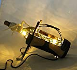HAVE A CORNER THAT YOU WOULD LIKE TO ILLUMINATE? BOOKSHELF? COUNTERTOP? BAR? SMALL TABLE? HERE IS AN ITEM FOR A GOLFER. Fun Table Lamp An Illuminated, 401K dark amber recycled wine bottle is incorporated into a ceramic golf bag. Very rich looking. It...