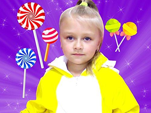 (Yasya eating colored lollipops )