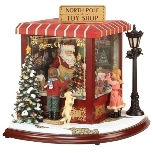 Amusements Exclusive Amusements Lighted Action Musical Featuring Santa in a Toy Shop with 2 Children Watching Him, 15.25 by 18-Inch