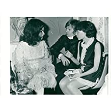 Vintage photo of Elizabeth Taylor along with Rudolph Nureyev and Mia Farrow