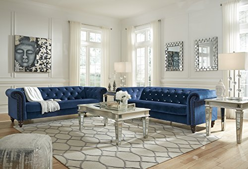 Ashley Furniture Signature Design - Malchin Casual Upholstered Sofa with Faux Crystal Button Tufting - RTA Sofa in a Box - Navy - CHESTERFIELD SOFA: Feeling star struck yet? We are with this timeless Chesterfield design. Chic detailing such as the rolled arms and diamond tufting provide that luxe finish you crave STYLISH COMFORT: High-resiliency foam cushions are wrapped in supple polyester with faux crystal button tufting. Designed with black nickel nailhead trim and exposed feet with a faux wood finish DEEP NAVY: Fashionistas rejoice—elevated style is brought to the forefront with this elegant shade of blue in your living room - sofas-couches, living-room-furniture, living-room - 51Gpd48a1dL -