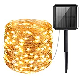 AMIR Solar Powered String Lights, Mini 100 LED Copper Wire Lights, Fairy Lights, Indoor Outdoor Waterproof Solar… 8 100 Brilliant LED lights - 100 Super Bright LED bulbs on 33ft high quality copper wire, with steady 360 degree viewing angle they illuminate in every direction. Ideal for decorating your gardens, patio, gate, yard, wedding, party etc. High Quality & Flexible Copper Wire - Made with thin and flexible copper wire, coiled with bobbin winder to avoid a mess, the solar powered string lights (low voltage,  no transformer included) is easy to storage and ready for the next use. Also, it is environmental- friendly, high energy conversion rate, durable and safe to use. 2 Switch Buttons - POWER ON/OFF. Auto on at dusk, auto off by day. MODE (Steady on / Flashing)
