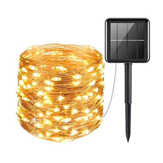 AMIR Solar Powered String Lights 1 100 Brilliant LED lights - 100 Super Bright LED bulbs on 33ft high quality copper wire, with steady 360 degree viewing angle they illuminate in every direction. Ideal for decorating your gardens, patio, gate, yard, wedding, party etc. High Quality & Flexible Copper Wire - Made with thin and flexible copper wire, coiled with bobbin winder to avoid a mess, the solar powered string lights (low voltage,  no transformer included) is easy to storage and ready for the next use. Also, it is environmental- friendly, high energy conversion rate, durable and safe to use. 2 Switch Buttons - POWER ON/OFF. Auto on at dusk, auto off by day. MODE (Steady on / Flashing)