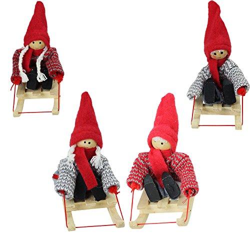 Set of 4 Colorful Holiday Kids on Sleds Christmas Ornamen...