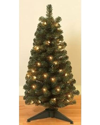 24 pre lit balsam pine tree w 90 tips and white lights not battery