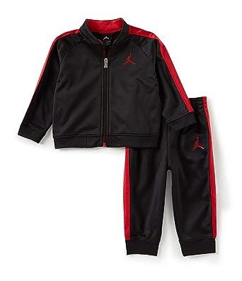 ca9681457 Amazon.com  Nike Boy`s Two Piece Tracksuit Jacket   Pants Set  Clothing