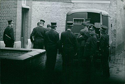 Vintage photo of Cops with prisoner. ()