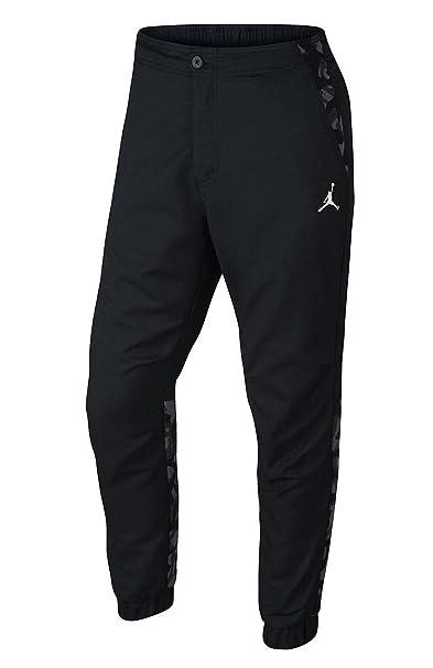 df2fb7ad5828d5 Nike mens AIR JORDAN CITY PANT 706723-010 30 - BLACK BLACK  Amazon ...