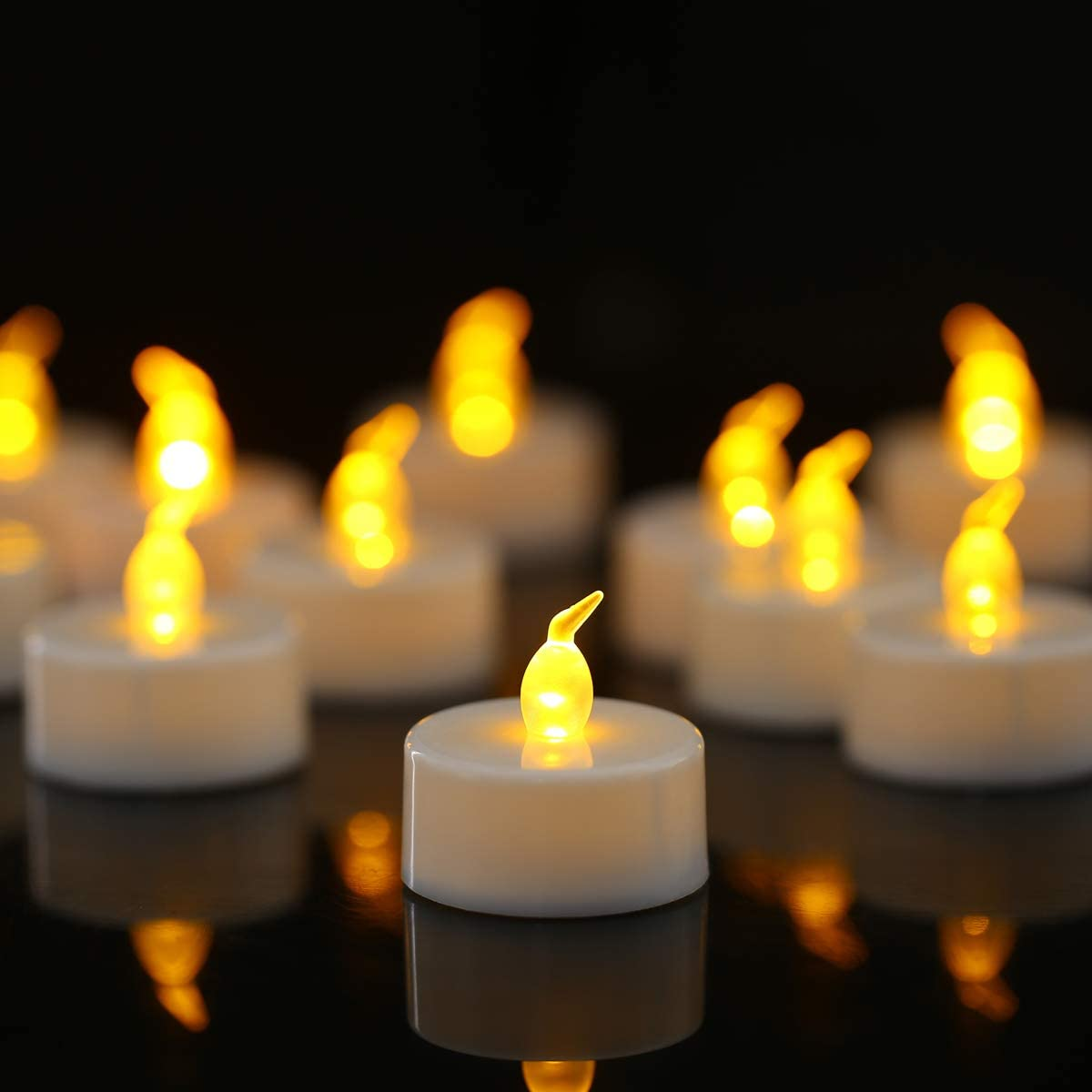 Amazon.com: Tea Lights 24 Pack Flameless LED Tea Lights Candles Battery  Powered Fake Candles 100 Hours Warm Amber for Wedding Party Holidays Home  Decoration Outdoor: Home & Kitchen