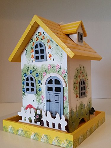 Garden Cottage Bird Feeder is decorated to compliment any patio garden this Wood Bird Feeder is hand painted with a Colorful Floral Print and a White Pickett Fence