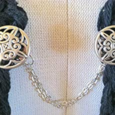 The mattie gold tone resin medallion sweater clip adds a touch of vintage elegance to your wardrobe. Sweater Clips Jewelry