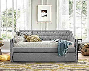 Gray hide-a-bed with trundle open and mattresses in place