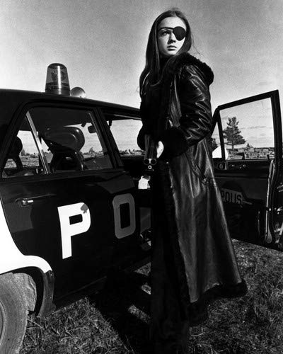 Christina Lindberg in Thriller - en grym film A Cruel Picture eye patch by police car 11x14 Promotional Photograph