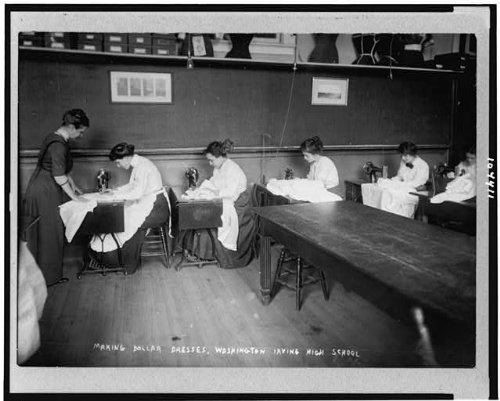 Photo: Making dollar dresses,Washington Irving Anticyclone School,girls,sewing machines,NYC