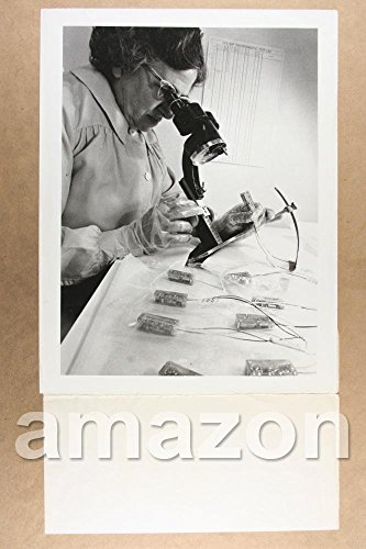 vintage-photo-of-woman-assembling-pacemaker-raytheon-company-industrial-lo265