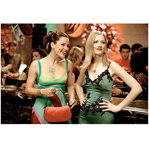 13 Going on 30 Jennifer Garner as Jenna Rink Wearing Striped Dress Holding Purse Smiling Big Standing at Bar with Judy Greer as Lucy Wyman Wearing Green Dress Hand on Hips Looking to Side 8 x 10 Photo