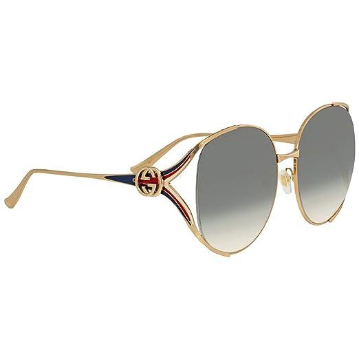 b23ff637fe Amazon.com  Gucci sunglasses (GG-0225-S 004) Gold - Blue - Blue Grey  Gradient lenses  Clothing